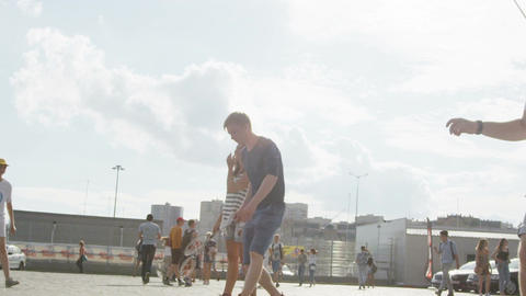 Slow Motion Young People Play Badminton on City Square Footage
