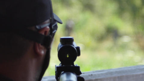 Military with a sniper rifle looks at the troop movement…, Live Action