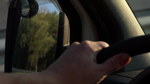 A big wing mirror is shot from a moving car in the evening in summer Footage