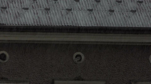 Old fashioned roof covered with grey slate in a rainy weather at slow motion Footage