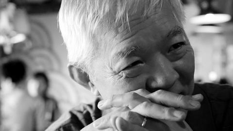 Asian Senior Guy Talking Happy In Restaurant With Family stock footage