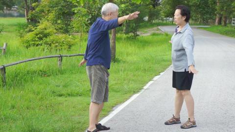 senior couple happy Asian senior couple walking exercise along the lake. Footage