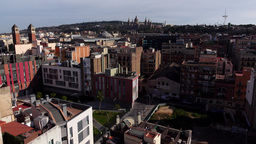 Static aerial Barcelona cityscape at sunny day, Montjuic hill and city roofs Footage