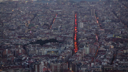 Charming aerial view at Barcelona streets glow between dull blocks, late evening Footage