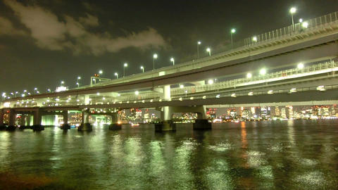 Golden reflections of city lights and bridge over the Tokyo waterfront ビデオ