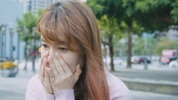 Woman coughing and sneezing at outdoor in the city Live影片