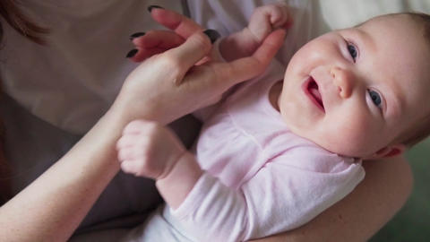 Mother's hand caresses the baby Footage