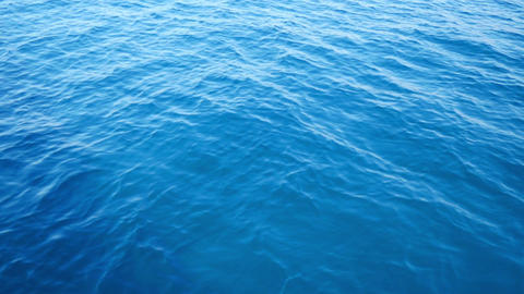 Beautiful blue calm Adriatic sea with small waves moving. Filmed from moving Live Action
