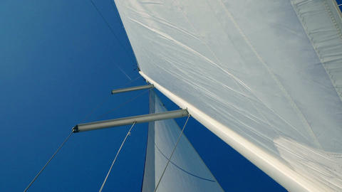 Main mast with main sail and front sail called flock. Moving from top of mast Footage