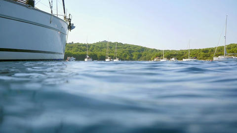 Man jumping from sailing boat into sea underwater shot in slow motion hd Footage
