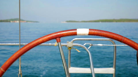 Sailing boat steering wheel closeup with beautiful blue Adriatic sea Footage