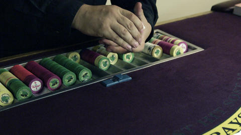 Dealer shuffling and dealing cards Footage