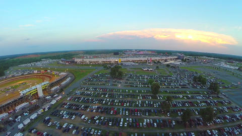 Fly over packed stadium parking lot ビデオ