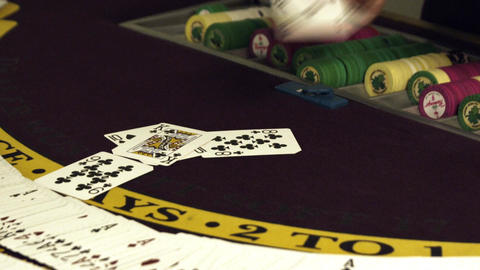 Dealing cards onto gambling table with chips Footage