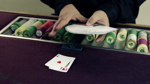 Dealer placing cards on the table Stock Video Footage