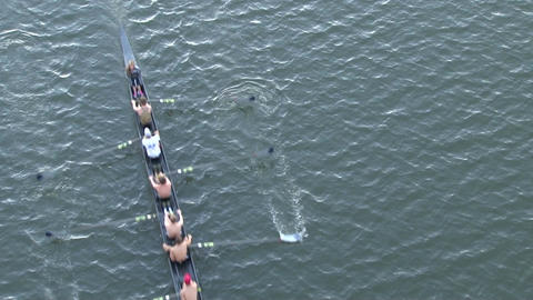 Rowing crew followed by boat Live Action