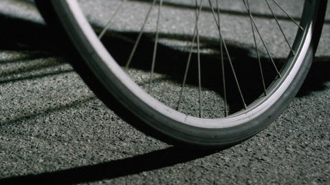 Closeup of bike tires skidding to stop 2 Footage