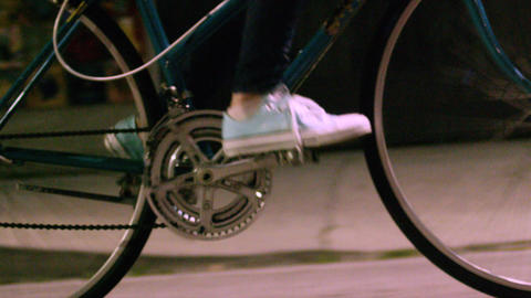 Closeup of feet pedaling bicycle Footage