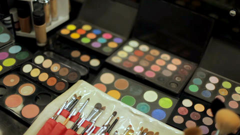 Professional cosmetics makeup artist on the table . Multicolored lipstick Footage