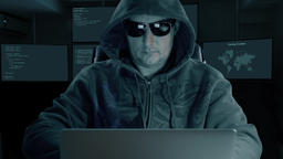 hacker typing at laptop. Man coding on computer dark night. Man in dark glasses Footage