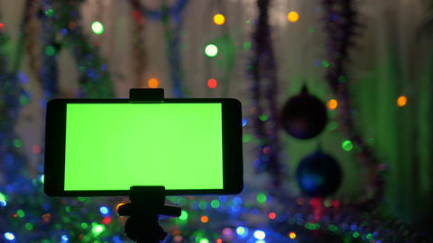A smartphone with a green screen. A great opportunity to add your greeting video Live Action