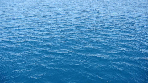 Blue mediterranean sea with small short waves. Filmed in slow-motion hd Filmmaterial