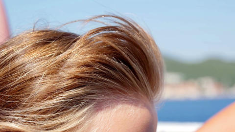 Girls hair waving in the wind on beautiful sunny day Footage