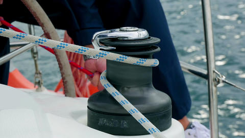 Sailing crew setting up sails and fixing ropes closeup in slow motion Footage