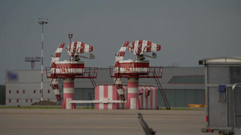 Radar system in warning stripes of red and white at Airport Live Action