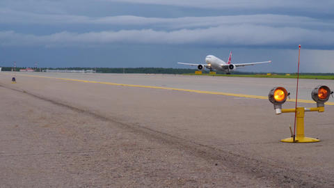 MOSCOW, RUSSIA - JULY 15, 2017: Nordwind Boeing 777 takes off by runway guard Footage