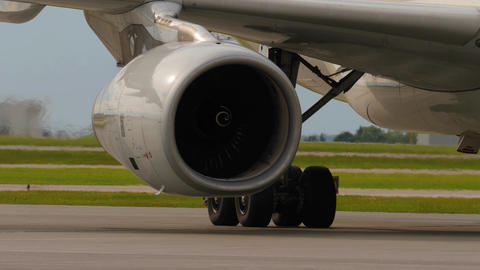 Heat shimmer behind jet engine and landing gear of taxiing airplane Image