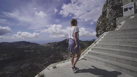 Women with action camera on selfie stick climbs stairs at Lovchen mountain Footage