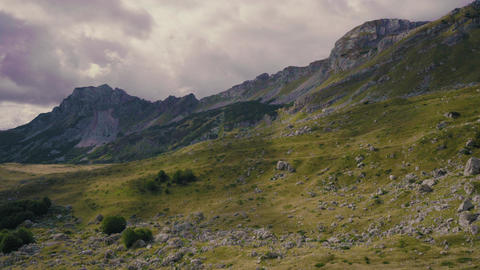 Rocky peaks and highlands of Montenegro mountains. Sun shines through clouds Footage