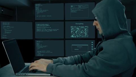 Hacker typing at laptop. Man coding on computer dark night. Man in dark glasses Live Action