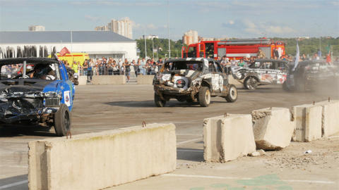Racing Vehicles Compete in Contest near Entertainment Center Live Action