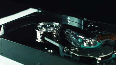 The inside of the hard drive. Disk with the head of data reading. Computer Footage