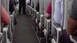Inside view of airplane aisle during flight. Passengers in their seats, cabin Footage