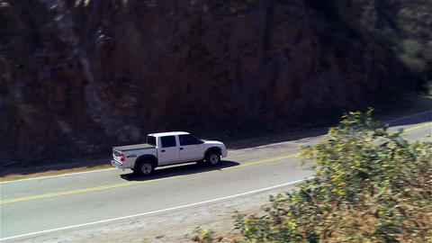 Automobile crosses Route in a Valley Live Action