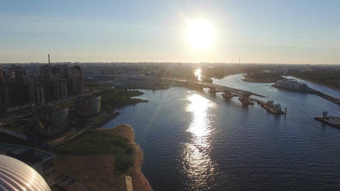 Flying over water towards highway bridge road construction site Footage
