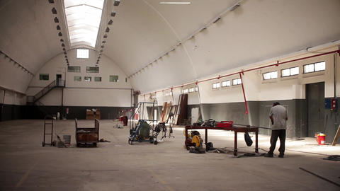 Man Working in Empty Warehouse Footage