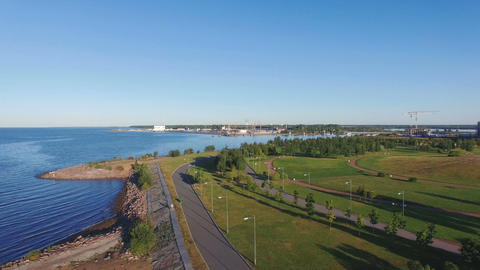 Recreation park with asphalt paths along the sandy beach sea shore Footage
