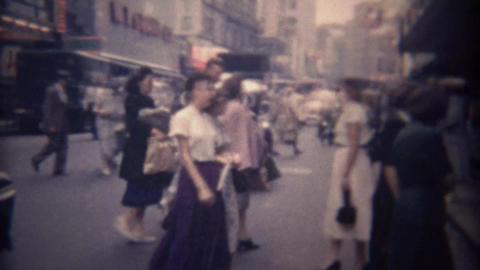 1948: Busy people cross downtown city shopping district streets Footage