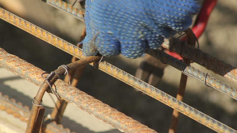 hand binds the reinforcing cage for bulding -close-up Live Action