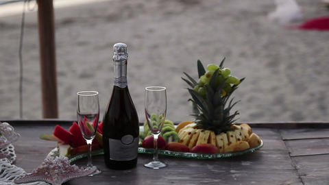 fruit and wine in the evening on the beach Footage