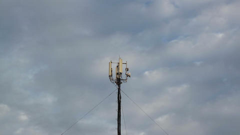 Cellular tower with antennas against the sky Footage