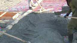 workers laid concrete mix to plate Footage