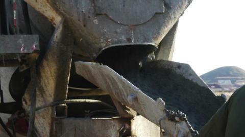 Concrete mixture flows through the trough Live Action