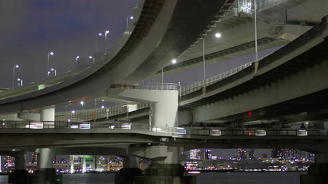 Motion time lapse of night commuters over the Rainbow Bridge Footage