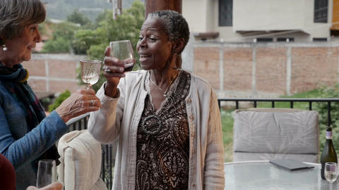 Three mixed racial senior baby boomer women in their 60s celebrating life with Footage