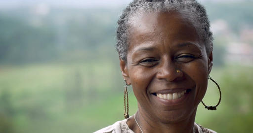 Portrait of a stunning African American woman in her 60s smiling at the camera Live Action